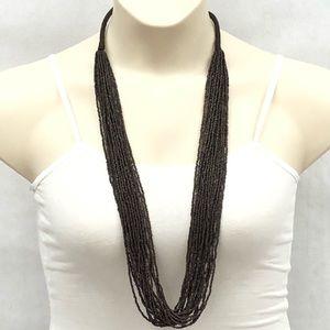 Dark brown beaded multi strand necklace